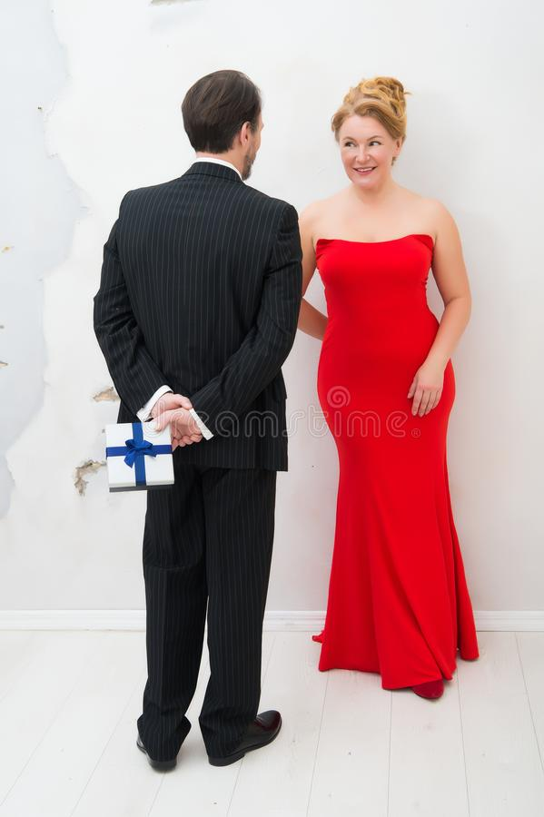 Delighted elegant woman expecting surprise from her husband stock image