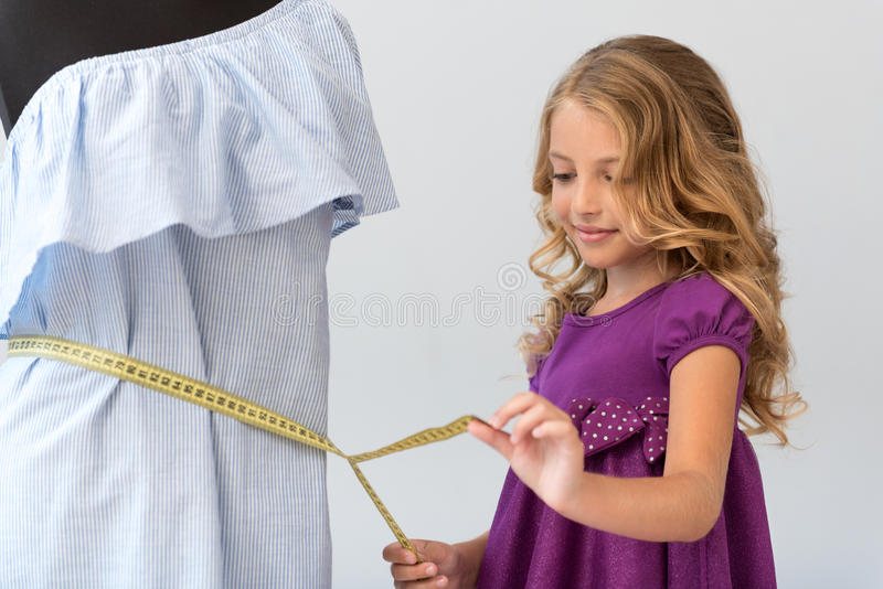 Delighted girl taking waist measurement royalty free stock photos