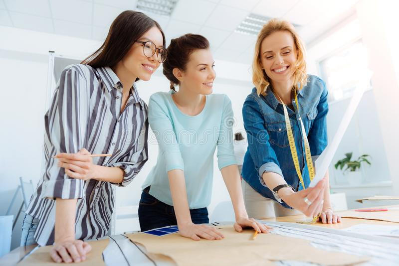 Delighted girls having friendly conversation royalty free stock photos