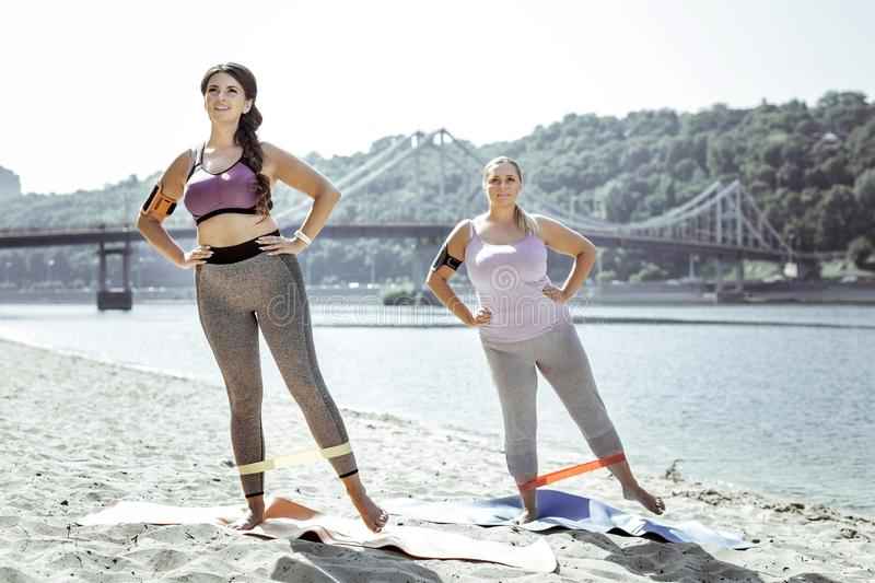 Delighted good looking women working out together stock photo