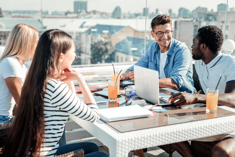 Delighted group mates spending break on terrace royalty free stock photos