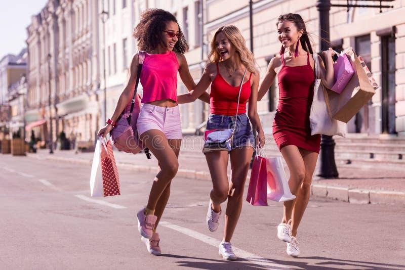 Delighted happy women enjoying their nice walk. So much fun. Delighted happy women laughing while enjoying their walk stock photo