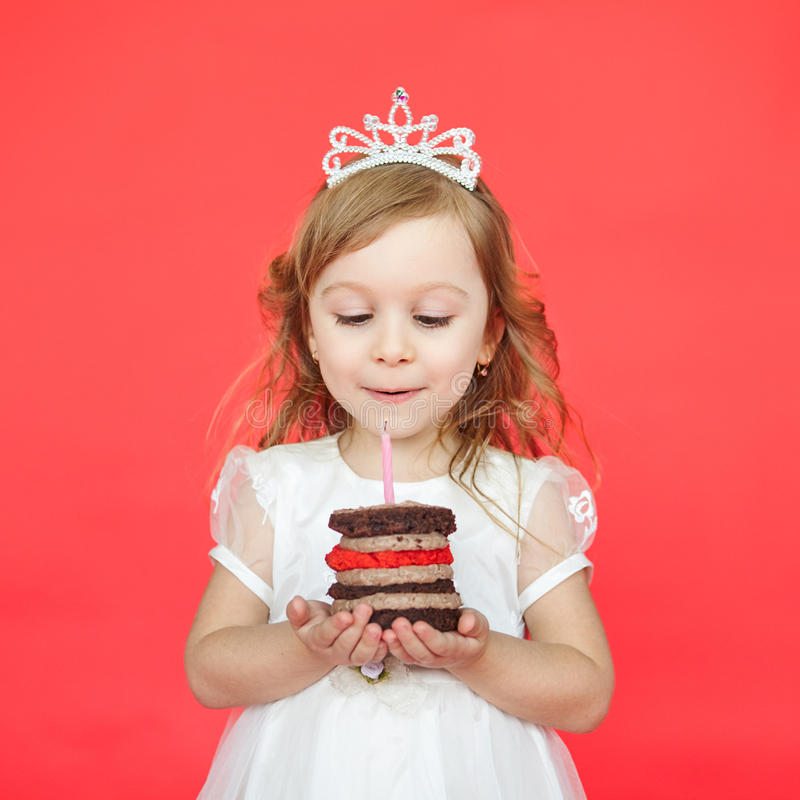 Delighted little girl blowing the candles royalty free stock photos