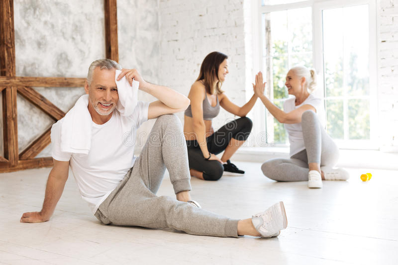 Delighted male person having rest after training stock photo