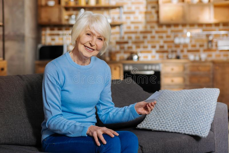 Delighted nice woman smiling stock images