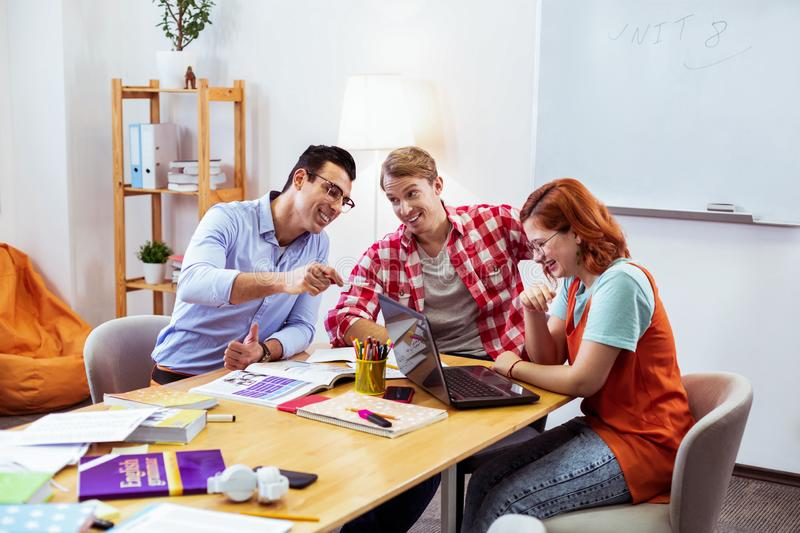 Delighted nice young students having fun together royalty free stock image