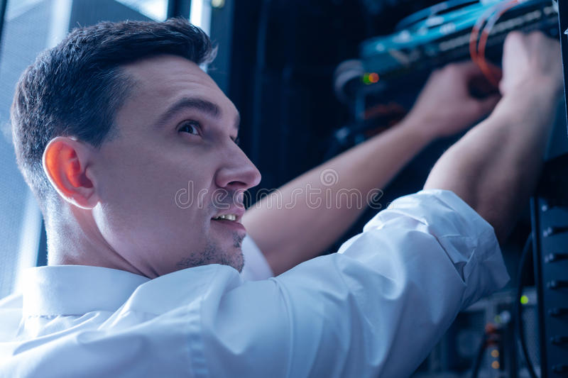 Delighted positive IT administrator enjoying his job stock photos