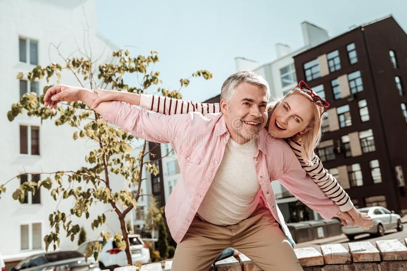 Delighted positive couple being in a great mood stock images