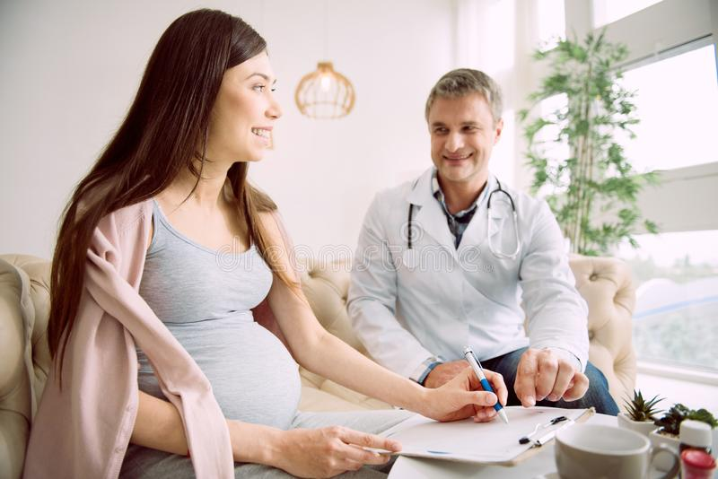 Delighted pregnant woman being in a good mood stock photography