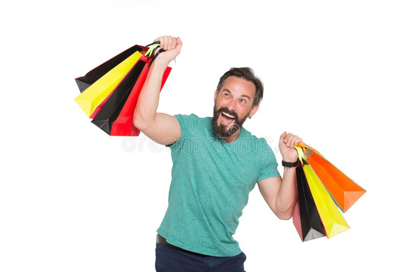 Delighted shopaholic being proud of his recent purchases. Sale. Waist up of positive mature bearded man being pleased with recent purchases while holding carton royalty free stock images