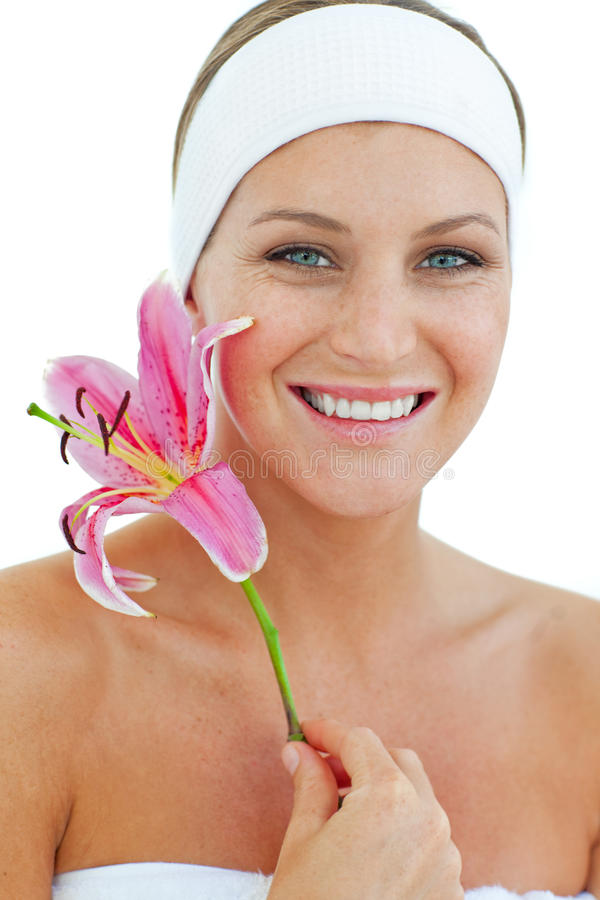 Delighted woman holding a flower royalty free stock photography