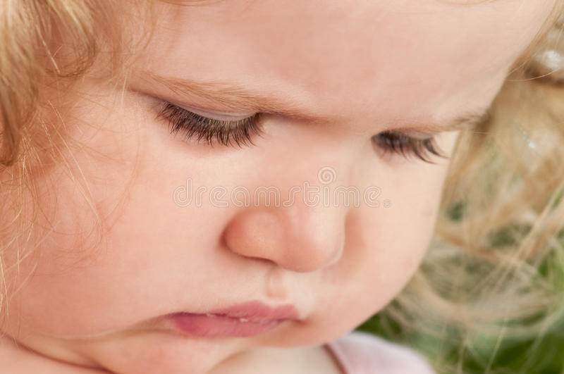 Delightful baby girl close up. stock photo