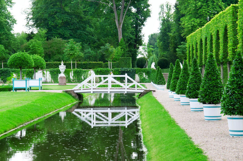 Delightful garden and pond stock photo