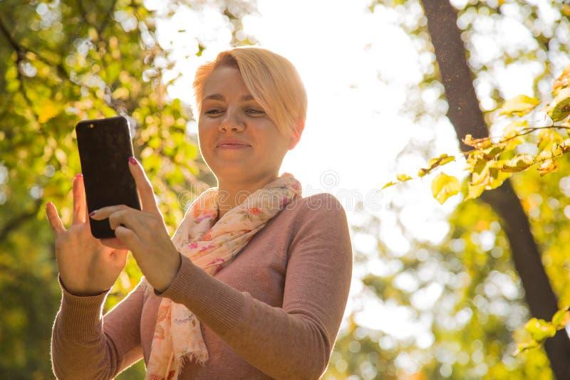 Delightful girl doing selfie stock image