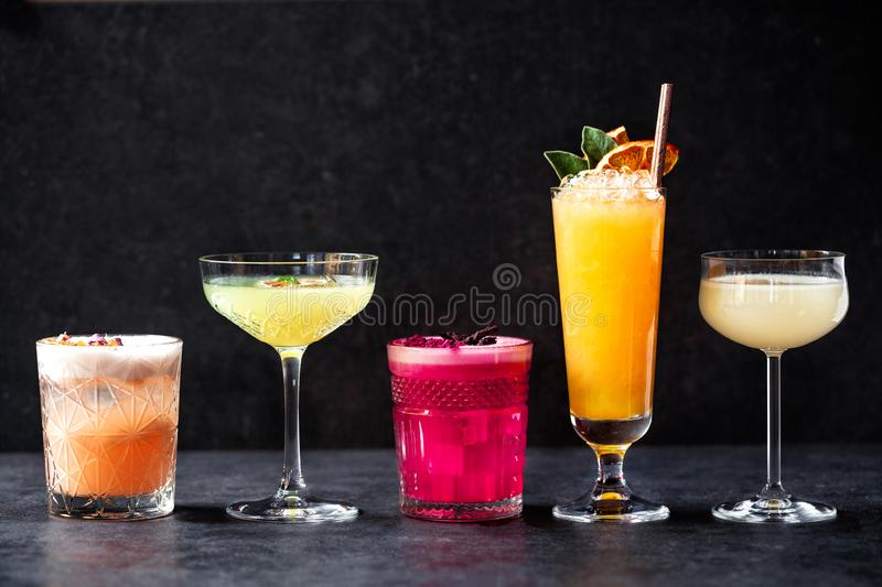 Delightful variously colored refreshment cocktail drinks stock photography