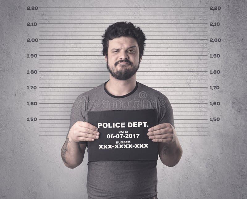 Delincuente cogido en cárcel fotografía de archivo libre de regalías