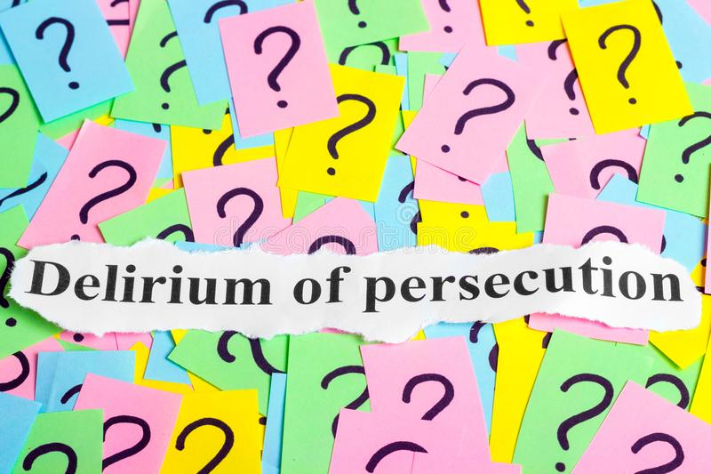 Delirium of persecution Syndrome text on colorful sticky notes Against the background of question marks. Delirium of persecution text on colorful sticky notes stock photography