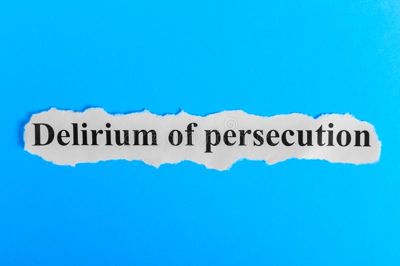 Delirium of persecution text on paper. Word Delirium of persecution on a piece of paper. Concept Image. Delirium of persecution Sy. Ndrome stock photo