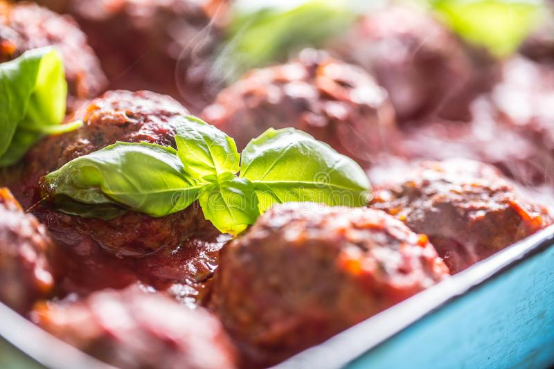 Delisious italian meal meat beef balls with basil in vintage roaster pan.  stock photos
