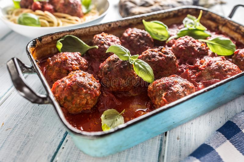 Delisious italian meal meat beef balls with pasta spaghetti and basil in vintage roaster pan.  stock images