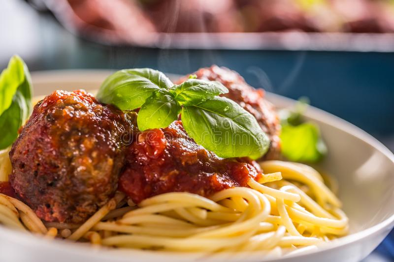 Delisious italian meal meat beef balls with pasta spaghetti and basil in white plate.  stock photo
