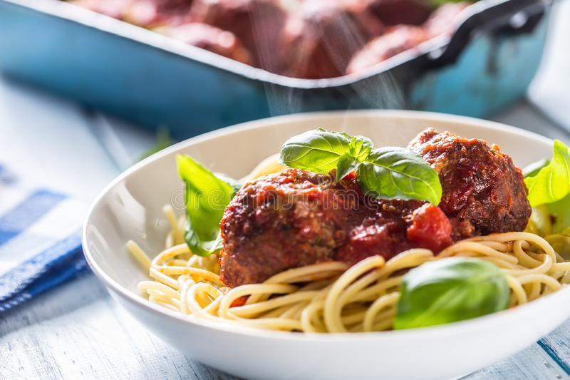 Delisious italian meal meat beef balls with pasta spaghetti and basil in white plate.  stock images