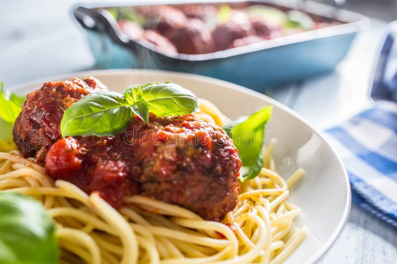 Delisious italian meal meat beef balls with pasta spaghetti and basil in white plate.  stock photos