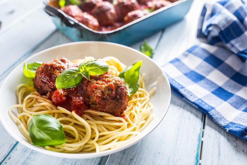 Delisious italian meal meat beef balls with pasta spaghetti and basil in white plate.  stock image