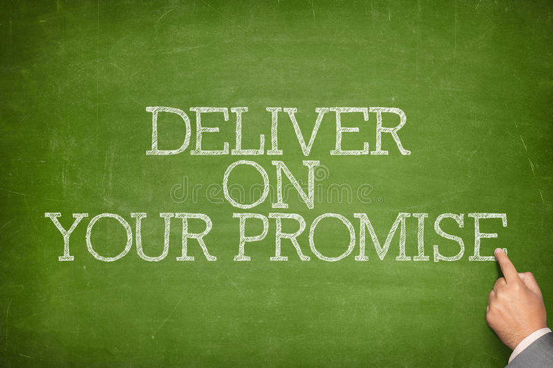 Deliver on your promise text on blackboard royalty free stock photo