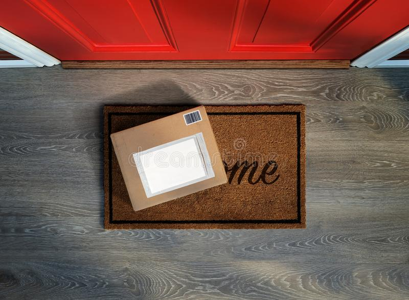 Delivered outside door, e-commerce purchase on welcome mat. Add your own copy and label royalty free stock photography