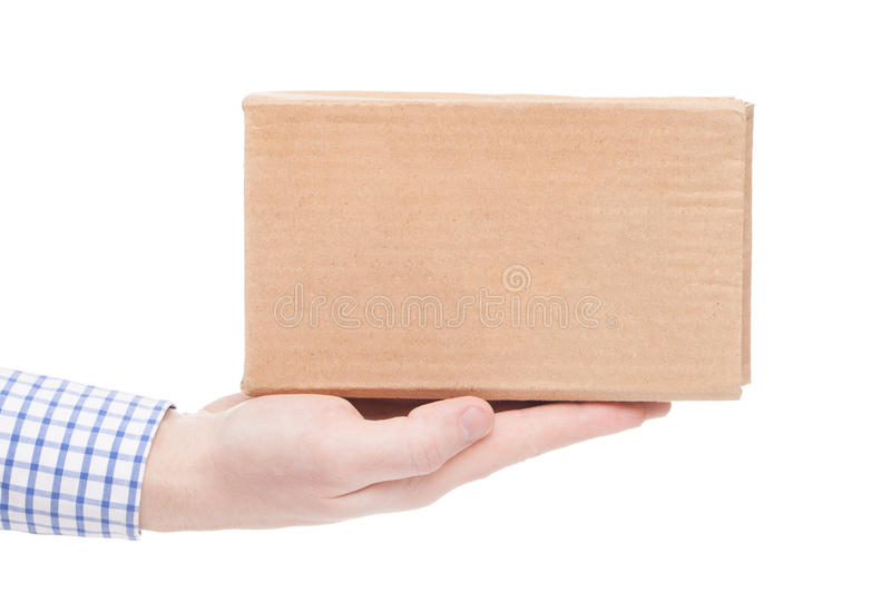Delivering of parcel to the customer (only one hand and parcel seen) - studio shot. Delivering of parcel to the customer (only one hand and parcel seen royalty free stock images