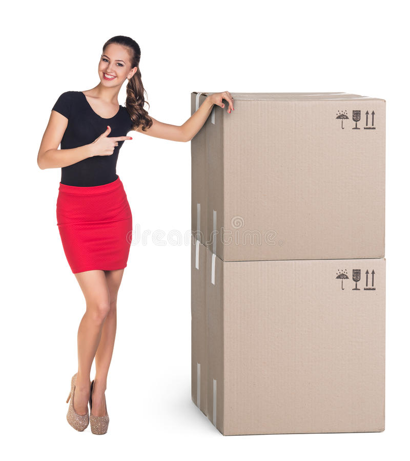 Delivery. Beautiful Woman with boxes on white royalty free stock photography