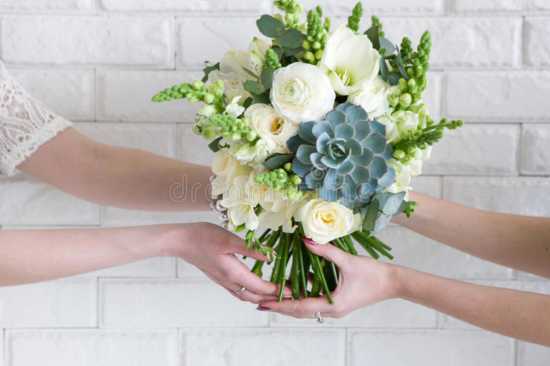 Delivery of bouquets from hand to hand royalty free stock photography