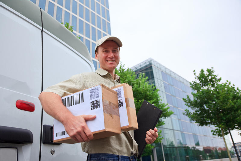 Delivery Boy Standing Next To His Van royalty free stock image