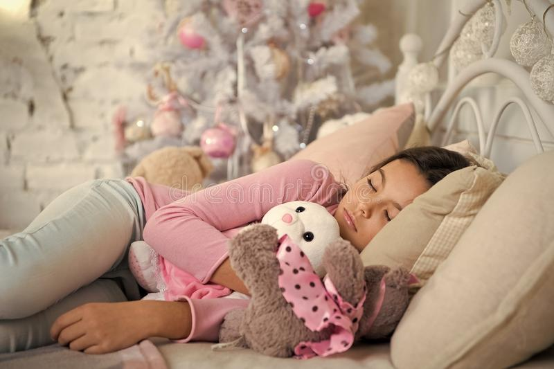 Delivery christmas gift. little child girl with xmas present. happy new year. happy little girl celebrate winter holiday. Christmas time. morning before Xmas stock photos