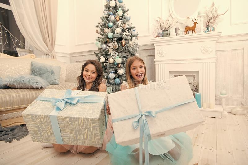 Delivery christmas gifts. Family holiday. happy new year. happy little girls sisters celebrate winter holiday. christmas. Time. Cute little children girl with stock photos