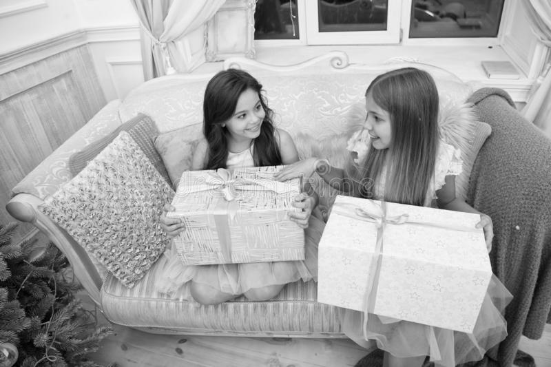Delivery christmas gifts. happy little sisters celebrate winter holiday. christmas time. Family. happy new year. Cute royalty free stock images