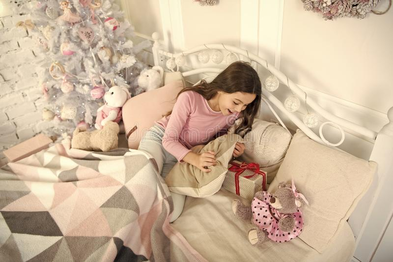 Delivery christmas gifts. happy new year. happy little girl celebrate winter holiday. sleeping and dreaming. christmas royalty free stock images