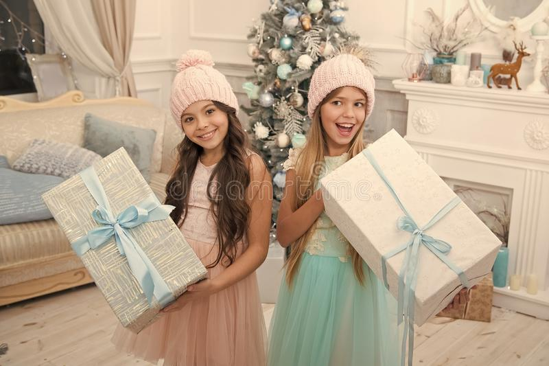 Delivery christmas gifts. happy new year. happy little girls sisters celebrate winter holiday. christmas time. Family. Holiday. little children girl with xmas stock photos