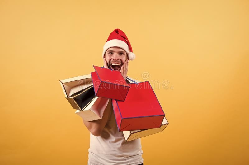 Delivery christmas gifts. happy santa man on yellow background. The morning before Xmas. man in santa hat hold christmas royalty free stock photos