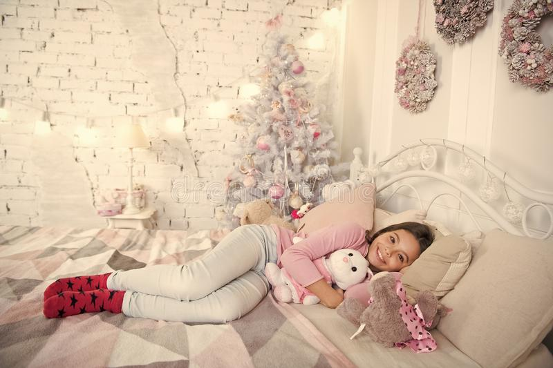Delivery christmas gifts. morning before Xmas. happy little girl celebrate winter holiday. christmas time. sleeping and stock photo