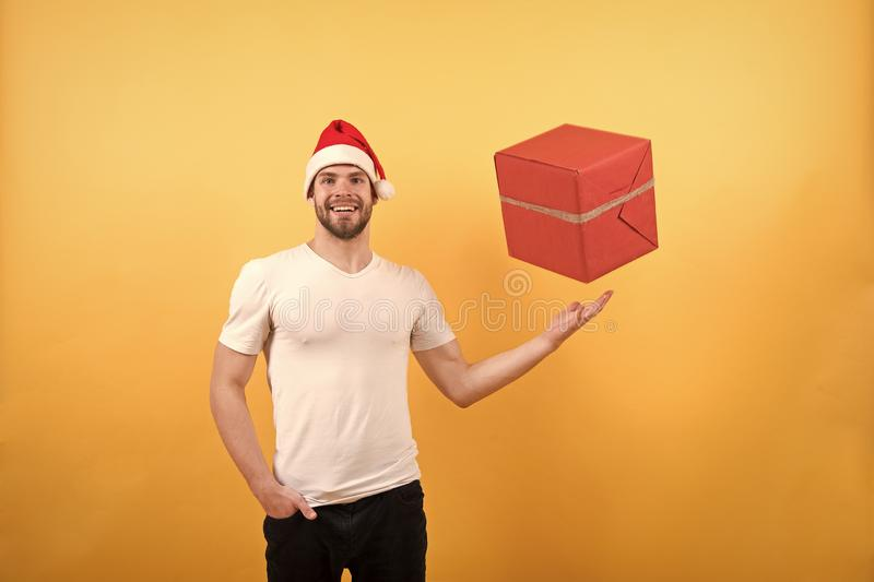 Delivery christmas gifts. The morning before Xmas. online christmas shopping. Happy new year. man in santa hat hold royalty free stock photography