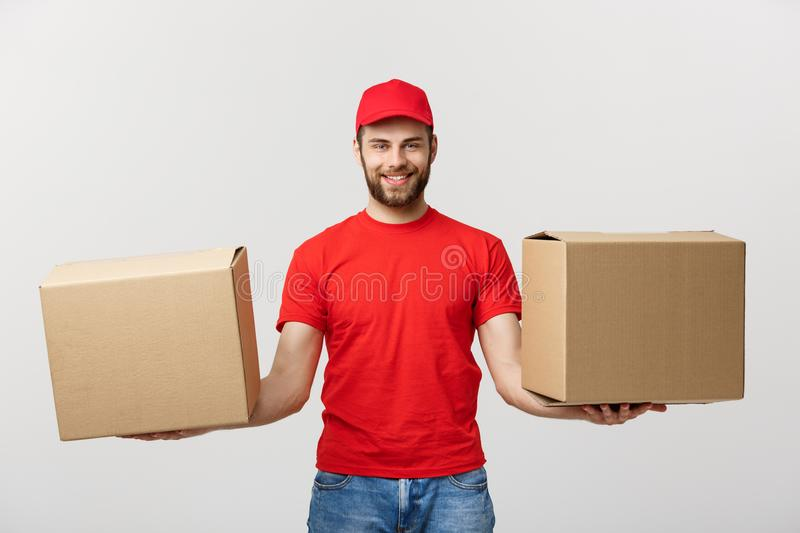 Delivery Concept: Portrait smiling delivery man giving cardbox on white background. stock images