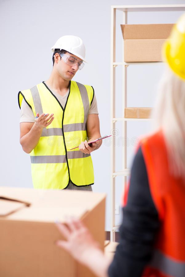 The delivery contractor delivering boxes to office. Delivery contractor delivering boxes to office stock photo