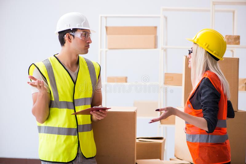 The delivery contractor delivering boxes to office. Delivery contractor delivering boxes to office royalty free stock image