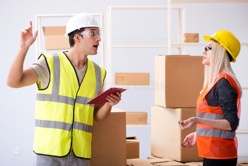 The delivery contractor delivering boxes to office. Delivery contractor delivering boxes to office stock images