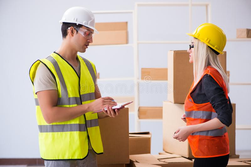 The delivery contractor delivering boxes to office. Delivery contractor delivering boxes to office stock photos