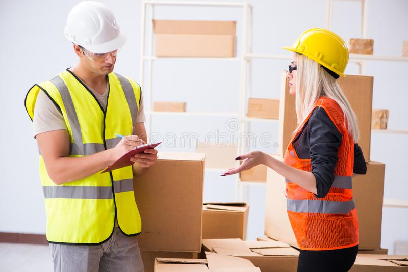 The delivery contractor delivering boxes to office. Delivery contractor delivering boxes to office royalty free stock photo