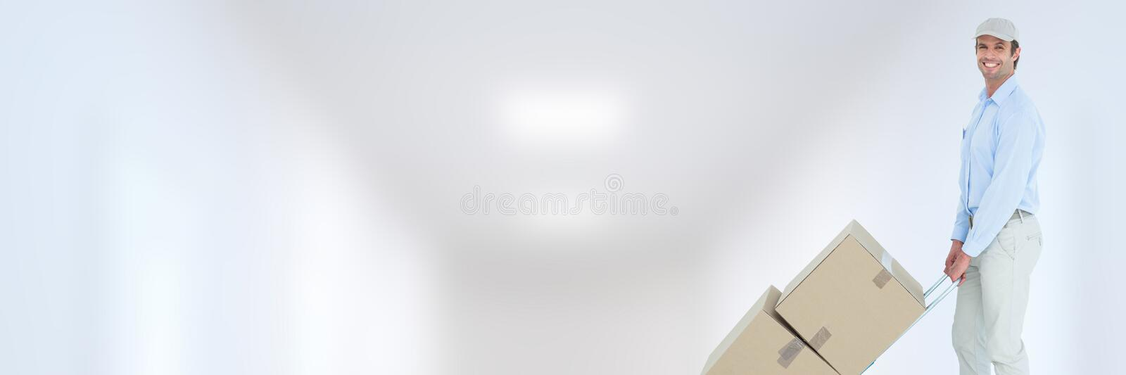 Delivery Courier with boxes in front of blurred background royalty free stock photography