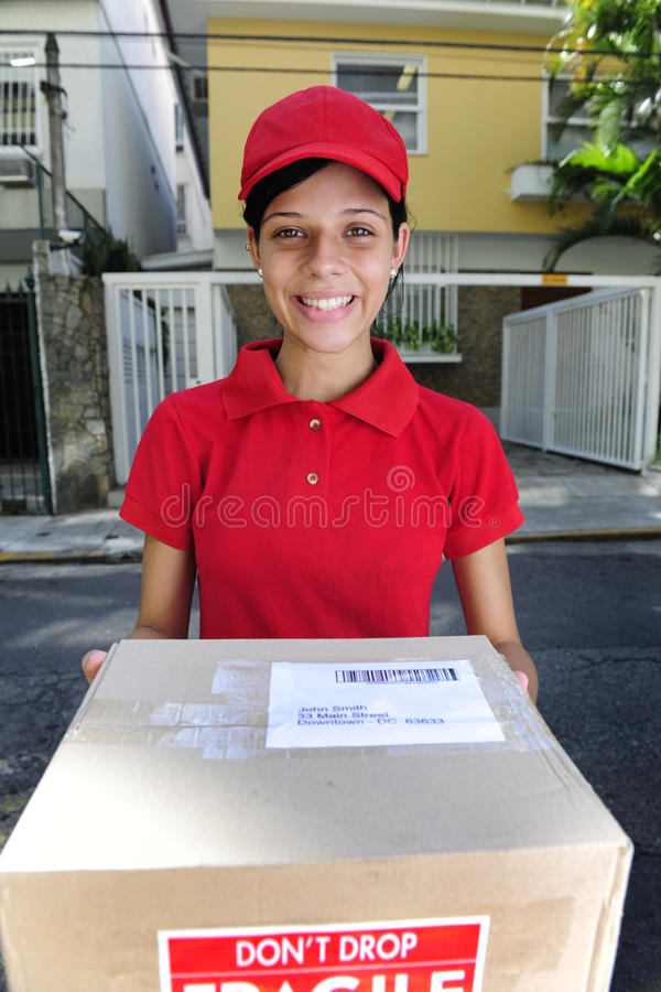 Delivery courier delivering package royalty free stock photo
